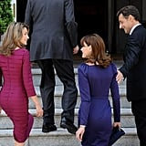 Nicolas Sarkozy reaches for his wife as they arrive at Spain's Zarzuela Palace with Princess Letizia.