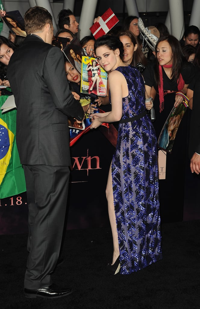 Robert and Kristen stopped to sign autographs.