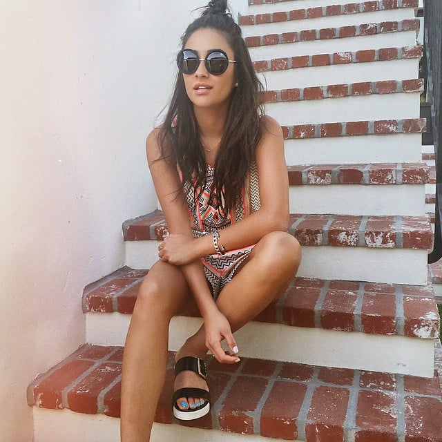 Rocking the half bun, Quay sunglasses, and Dr. Scholl's Original Collection Frill Slide Sandal ($88) like a true style star.