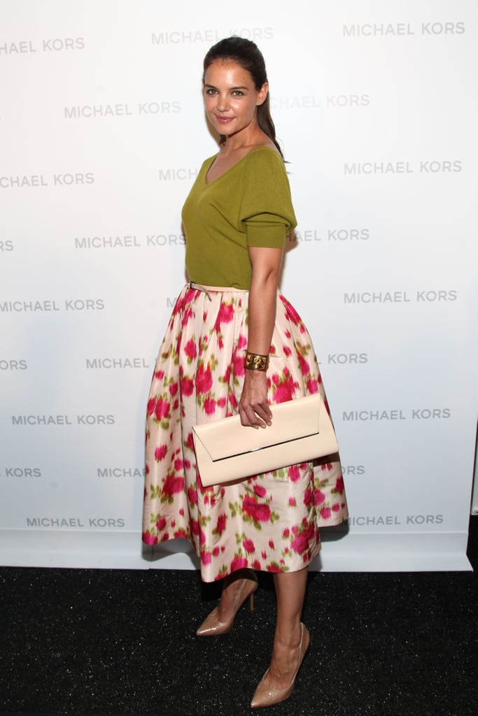 Katie Holmes posed for photos at the Michael Kors runway show.