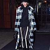 Hailey Baldwin covered up in a plaid coat that perfectly suited the cooler weather.