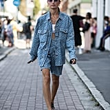 The double denim look balmy days? Bermuda shorts and an oversize jean jacket with a tank and sandals.