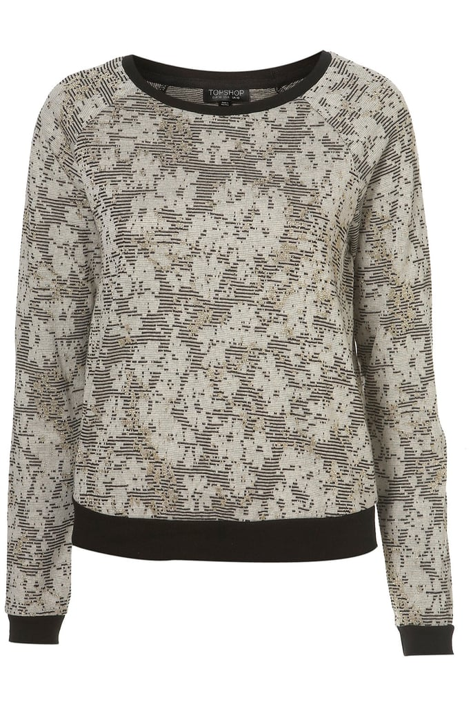 For a more laid-back look, wear something with a dash of floral and metallic detail, as seen on this cozy topper. Topshop Lurex Jacquard Floral Sweatshirt ($56)
