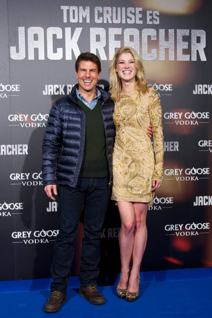 Tom Cruise and Rosamund Pike made a pretty pair as they posed on the blue carpet for their new film, Jack Reacher, on December 13.