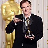 Quentin Tarantino showed off his Oscar for best original screenplay.