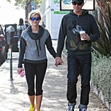 Reese Witherspoon and Jim Toth showed sweet PDA during their walk in LA on Friday.
