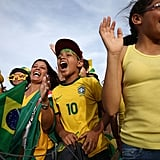 Brazil fans cheered as they stood outside Itaquero Stadium during the World Cup opening ceremony rehearsals.