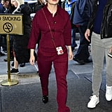 In New York wearing a striped red set and black boots.