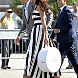 On the eve of the wedding in 2014, Amal was spotted in a black-and-white striped dress and a pair of classic slingback heels.