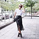 A White T-Shirt, Black Fringed Skirt, and Booties
