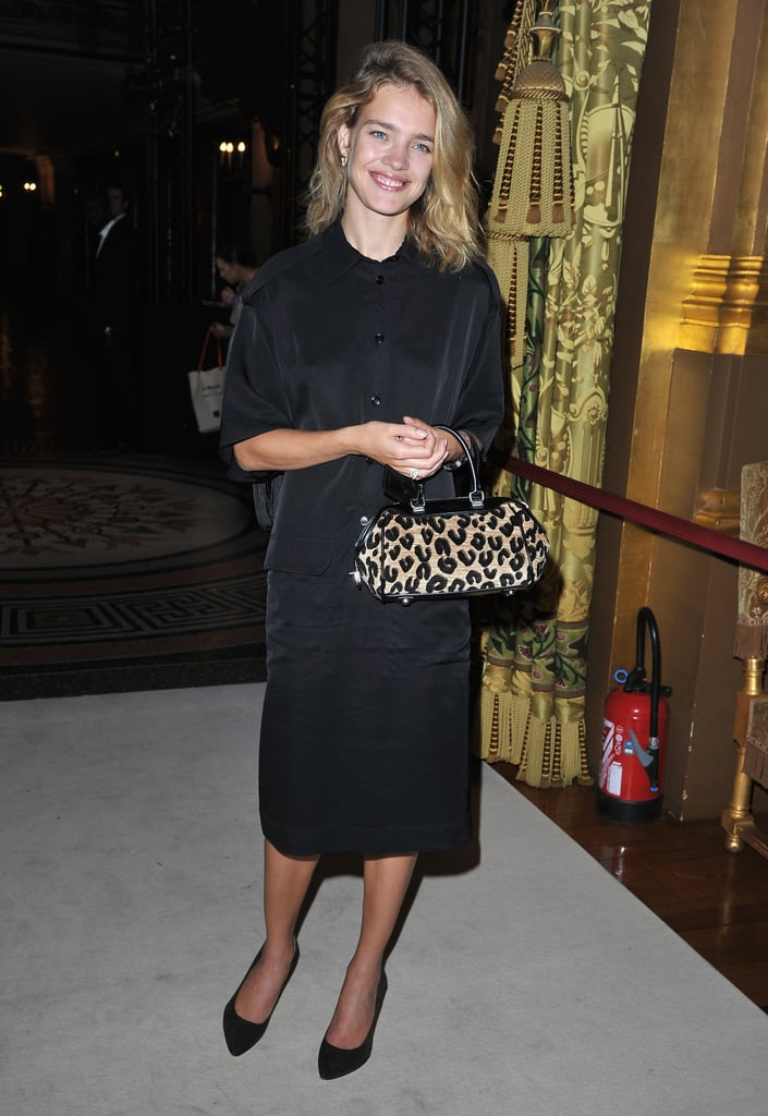 Natalia Vodianova punctuated her modest black dress with a ladylike-meets-exotic leopard print tote at Stella McCartney's Spring '13 show.