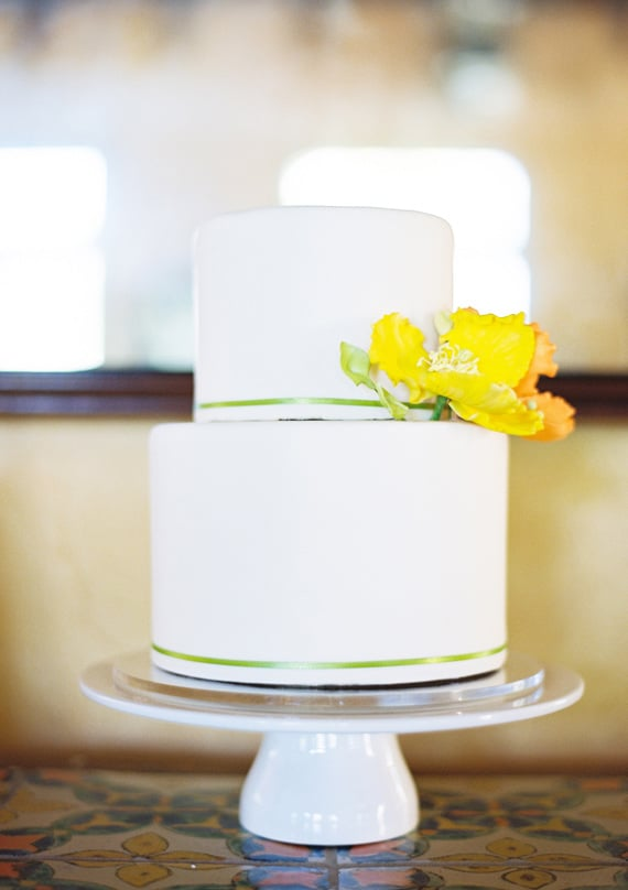 A few touches of complementary colors really make this one simple, special cake.   Photo by Connie Lyu via 100 Layer Cake