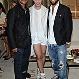 Cuba Gooding Jr. posed with Johnny Weir and designer Chris Benz in the Moet & Chandon suite.