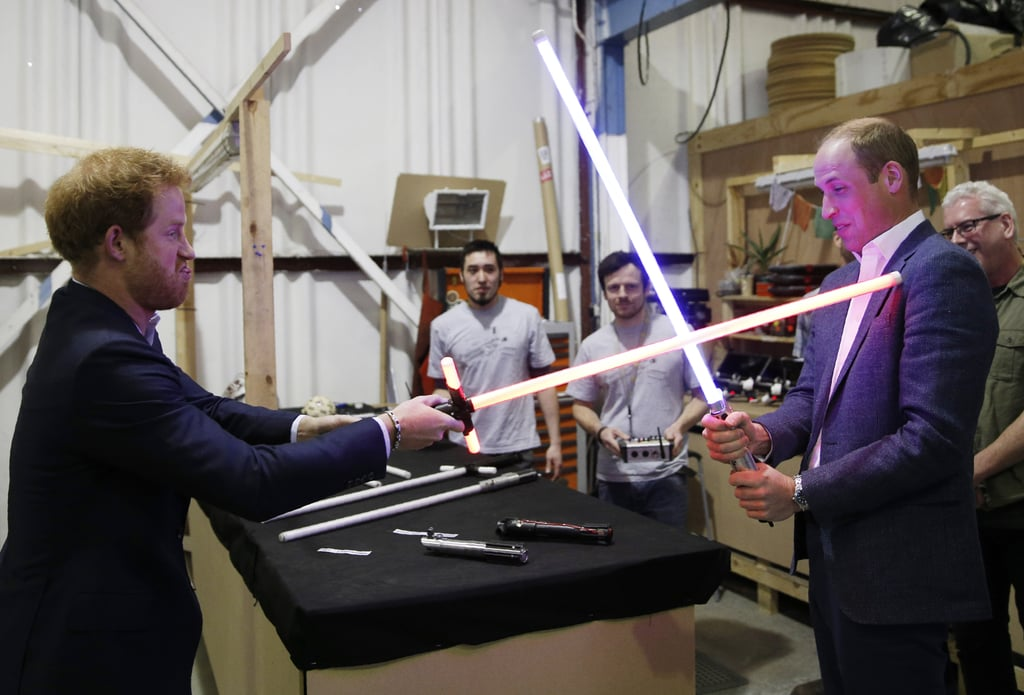 Harry and William duelled each other with lightsabers while visiting the Star Wars set at England's Pinewood Studios in April.