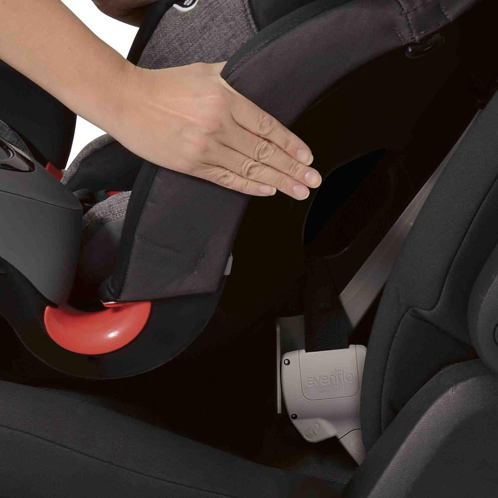 """What could be better? Certainly not as narrow as a standard booster, the SecureKid DLX All-in-One is pretty wide at 27.7 by 19.7 by 19.5 inches, meaning if you are trying to fit three kids across a standard car's rear seat, you're going to have a tough time doing so. Also, while the extended headrest gives kids added protection during a side impact collision, it also reduces a child's ability to see his surroundings. On several occasions, my son complained that he couldn't see out the window —or for that matter, his brother in the next seat over — and he could only look forward. And, while most convertible car seats have a """"base"""" on them that lifts kids up, this seat functions more like a booster on the bottom, so the seat is flush with the car's seat, so if you have a smaller child in the seat, it is actually difficult to see him in your rear-view mirror. Finally, I found the chest clip on the five-point harness really difficult to undo — which is great in preventing kids from undoing it themselves, but really annoying to a parent who is trying to get her kid out of the car in a hurry. While I thought it was just me, several people tried it for me and had similar issues undoing it."""