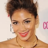 A swept-back hairstyle, false lashes, and bright lips gave Nicole a new look at the Cosmopolitan Ultimate Women of the Year Awards in December 2013.