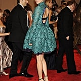 Revealing a hint of skin via an open-backed, lacy turquoise dress at the Met Costume Institute Gala in May this year.