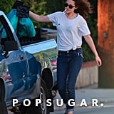Kristen Stewart threw bags into the trunk.