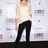 Karlie Kloss kept it simple in a white knit, skinny black jeans, and classic pointy-toe pumps.