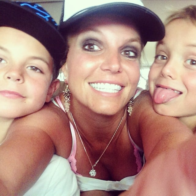 When it comes to selfies, Brit's minimes are pros. She shared this snap of the trio in August 2014.