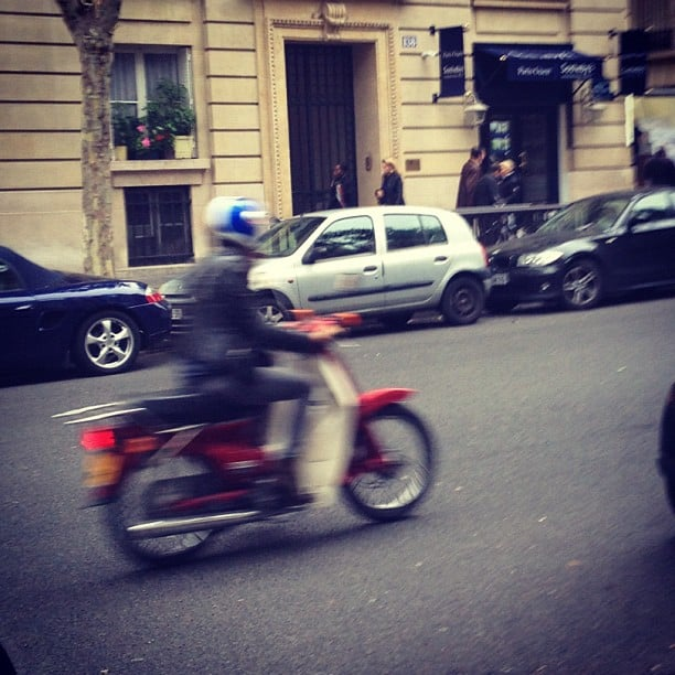 That's Isabel Marant scooting away in a leather jacket in Paris.
