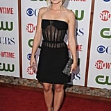 Kristen Bell in a black Versus dress and Ferragamo clutch.