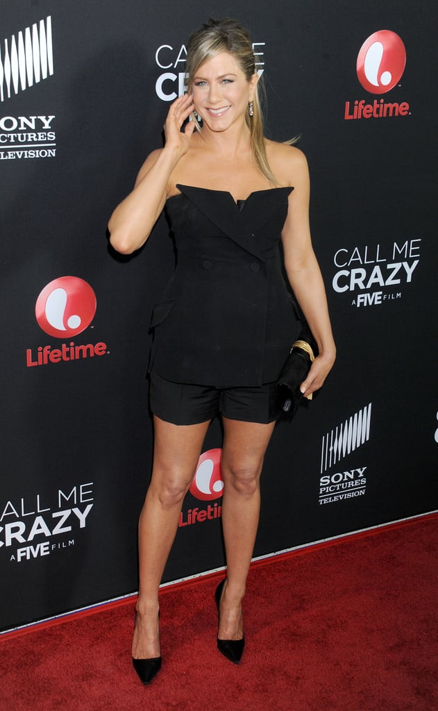 """Jennifer Aniston put her fit frame on display last night when she attended the LA premiere of Call Me Crazy: A Five Film in a black Christian Dior ensemble. She was joined by another Jen — Jennifer Hudson — who stars in the film alongside an A-list cast that includes Melissa Leo, Octavia Spencer, Modern Family star Sarah Hyland, and Jennifer Aniston's buddy Chelsea Handler. The film deals with mental illness and Jennifer serves as an executive producer for the movie as well as the Five series, which airs on Lifetime. She opened up about the touchy subject that dominates her new film at the Call Me Crazy opening last night, admitting that she and her producing partners picked the subject because it affects so many people. Jennifer said, """"We were sort of banging our heads around for the second round of Five and this sort of came to us and it's because so many people have been affected or someone you know is affected.""""  Even though Jennifer attended the event without fiancé Justin Theroux, he and the couple's upcoming nuptials were still a hot topic of the night. Jennifer said she still hasn't picked out a wedding dress, despite earlier reports that she would tie the knot soon after she wrapped up filming for the still-untitled film based on an Elmore Leonard novel."""