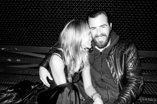 Jennifer Aniston hugging Justin Theroux.