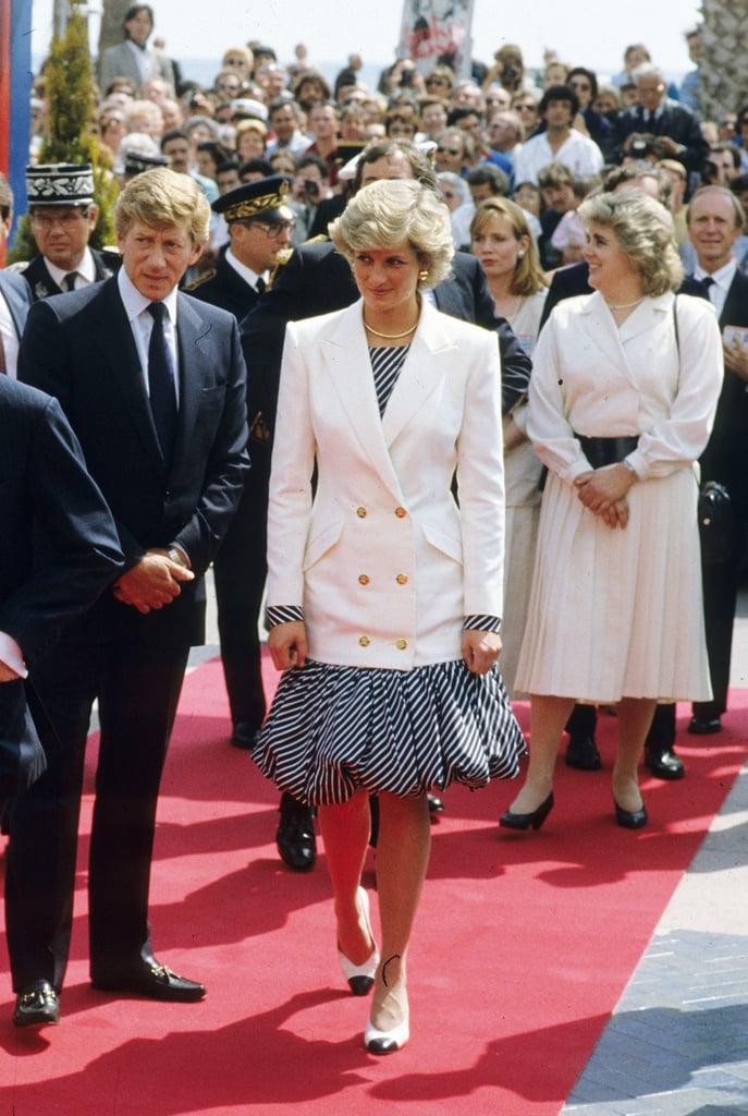 For her first appearance on the Cannes Film Festival red carpet, Diana wore a puffy Catherine Walker dress with a double-breasted white blazer.