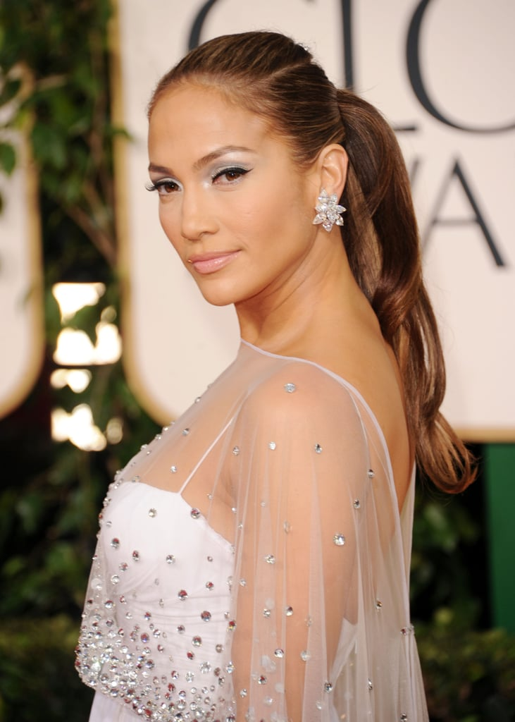 Jennifer was dripping with ice at the 2011 Golden Globes, from her frosty shadow to her sparkly hair accessory atop a double ponytail.