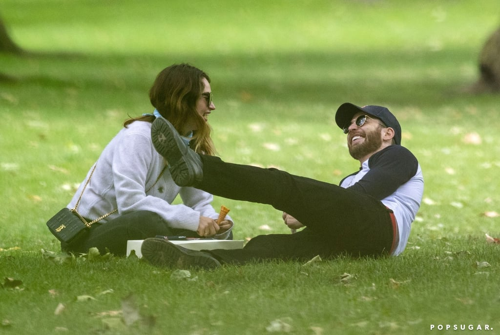 Chris Evans and Lily James continue to fuel those dating rumours. After the pair were photographed hanging out in London over the weekend, the actors were spotted on a cute park date on Tuesday. The 39-year-old Captain America actor and 31-year-old Mamma Mia! Here We Go Again star seemed to be enjoying their time together as they laughed, ate ice cream, and lounged on the grass. Lily currently lives in London, and it's unclear whether Chris might be filming a project in the city, where several TV and movie projects have resumed production. The pair hasn't confirmed a relationship; Lily previously dated her Pride and Prejudice and Zombies costar Matt Smith, though they reportedly split this past December, and Chris was last linked to his Gifted costar Jenny Slate, but they broke up in March 2018.      Related:                                                                                                           Just a Ton of Extremely Wholesome Pictures of Chris Evans and His Rescue Dog, Dodger