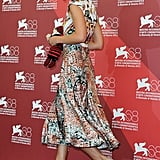 Keira Knightley carried a doll onto the red carpet at the Venice Film Festival.