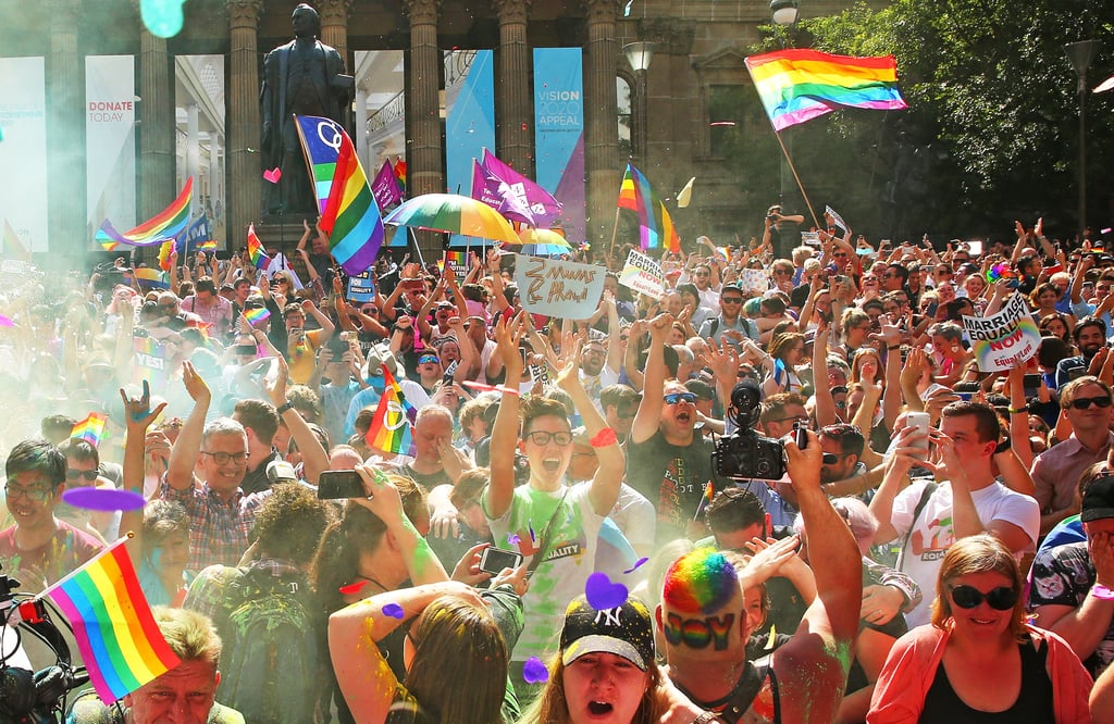The early morning call of 10 a.m. on a Wednesday didn't prevent Australians from coming together in their thousands to stand side by side, and am in arm, to watch the announcement of the result of the Marriage Equality Survey. When it was confirmed that there was a majority Yes vote, people shared their joy in mass celebration.