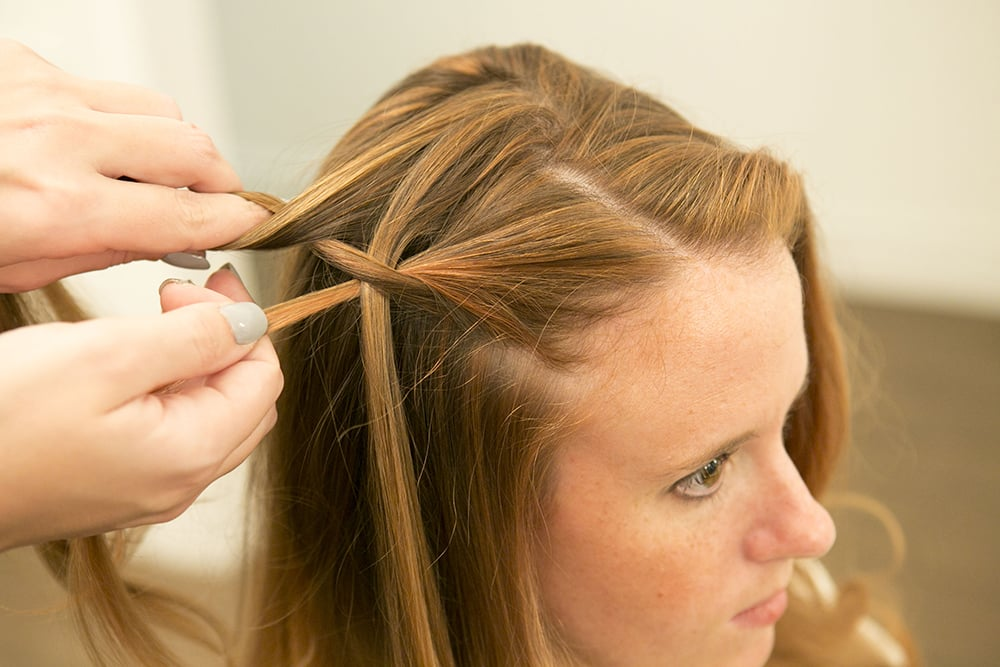 Take the bottom section of hair, and pull it over the waterfall section. Then take another section of hair from the top of your head to make another waterfall piece.