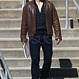 Tom Cruise wore a brown leather jacket on set.