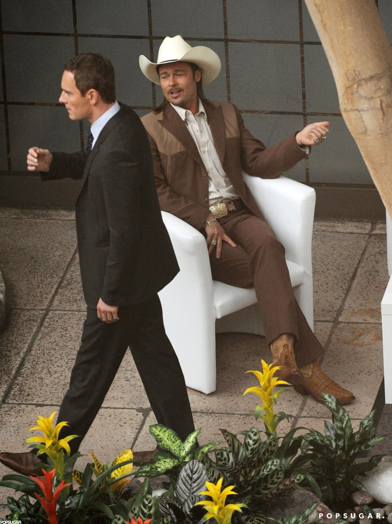 Brad Pitt got into character with a cowboy hat and facial hair for The Counselor in London this week. He started work yesterday on the Ridley Scott-directed film, which he'll apparently only shoot for a few days. The drama is based on a screenplay by author Cormac McCarthy and follows a lawyer as he gets into the drug business. Michael Fassbender joined Brad in front of the cameras today. Also reportedly lined up for the project are Cameron Diaz, Penelope Cruz, and Javier Bardem.  Brad's on set in the UK, where he and Angelina Jolie have been staying as a family since Angelina began filming Maleficent in June. She's been in full costume and has had visits from her kids in between takes. Brad, meanwhile, traveled to Germany and also met up with pal George Clooney in the UK during his downtime.