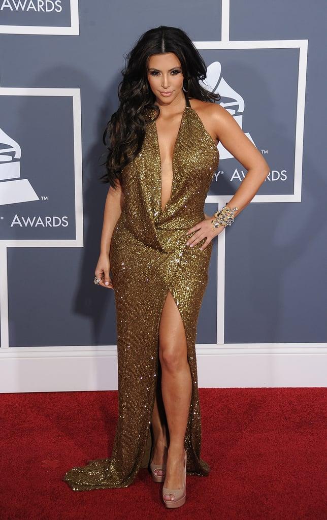 Kim Kardashian rivalled Jennifer Lopez in a sexy gold dress at the February 2011 Grammys in LA.