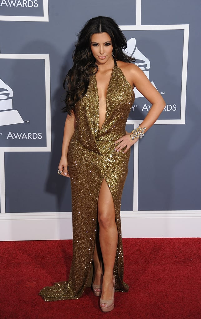 Kim rivaled Jennifer Lopez in a sexy gold dress at the February 2011 Grammys in LA.