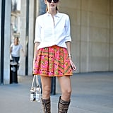 Take a cue from your prep school days by pairing a classic white shirt with a bold miniskirt.