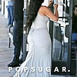 Kim Kardashian Gray Maxi Skirt and Sneakers