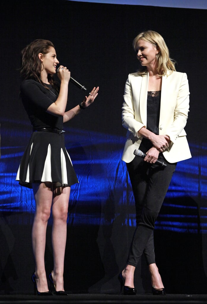 Kristen Stewart sported a short Cushnie et Ochs dress to hit the stage at CinemaCon in Las Vegas on Thursday. She was joined by her Snow White and the Huntsman costar Charlize Theron, who was in a similar black and white getup. The twosome are kicking off promotion for their movie ahead of its June 1 release and they will soon be bringing it overseas to London, where one lucky PopSugar winner will get to meet Kristen in person for our latest I'm a Huge Fan! The gorgeous twosome, Kristen and Charlize, are both early front-runners in the 2012 PopSugar 100. We revealed the PopSugar 100 top 10 at the end of the second day of voting, but there's a long way to go before we announce the final list in June. Just in time for this big moment, we also got brand-new Breaking Dawn Part 2 pictures showing vampire Bella alongside Edward Cullen.  Yesterday's CinemaCon festivities also brought out Battleship castmembers Taylor Kitsch and Brooklyn Decker, as well as Mila Kunis, John Travolta, Salma Hayek, Jeremy Renner, and more. It's the last night of the weeklong Vegas event, which also brought us Jennifer Garner's first postbaby red carpet.