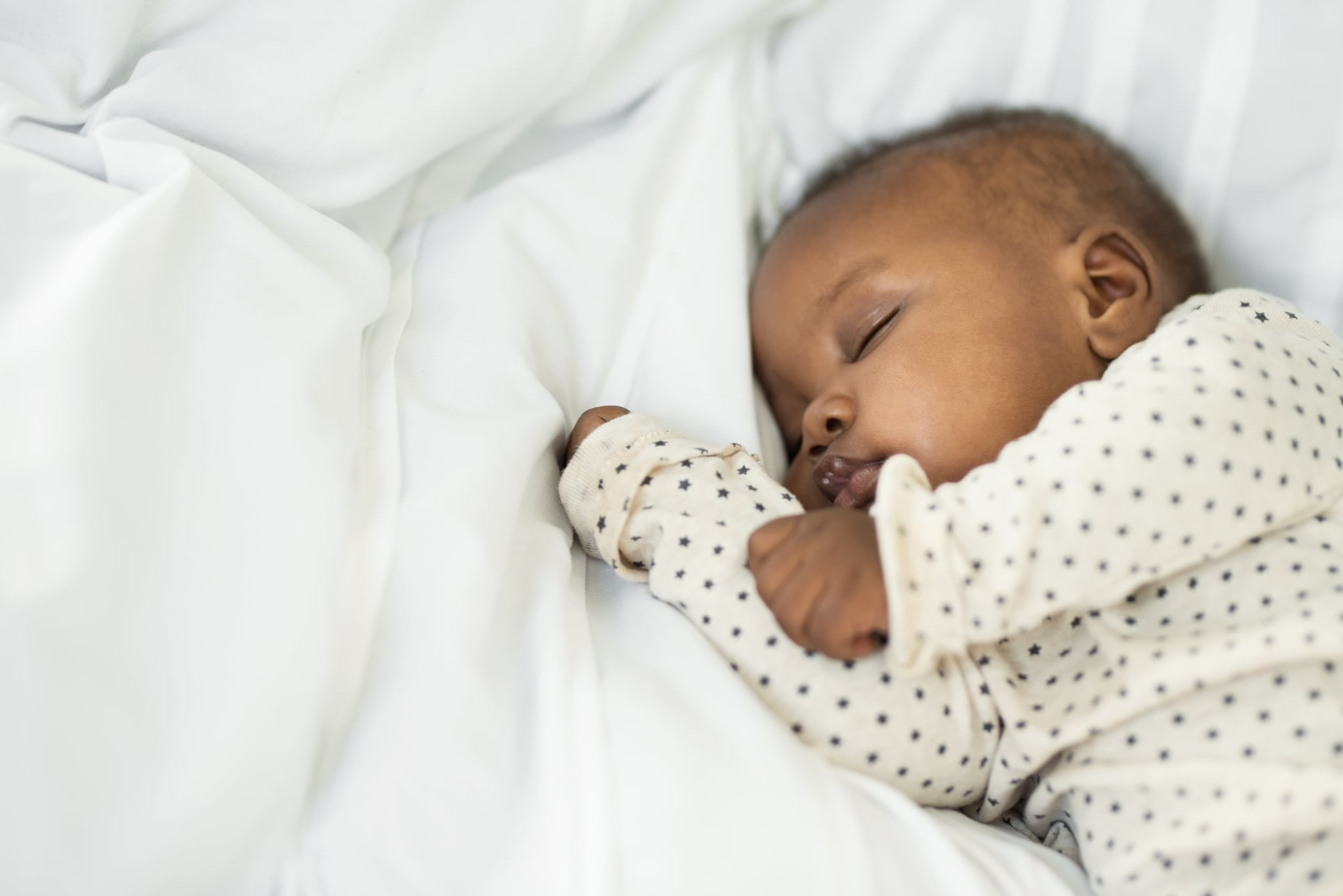 Cropped shot of a baby girl sleeping peacefully at home