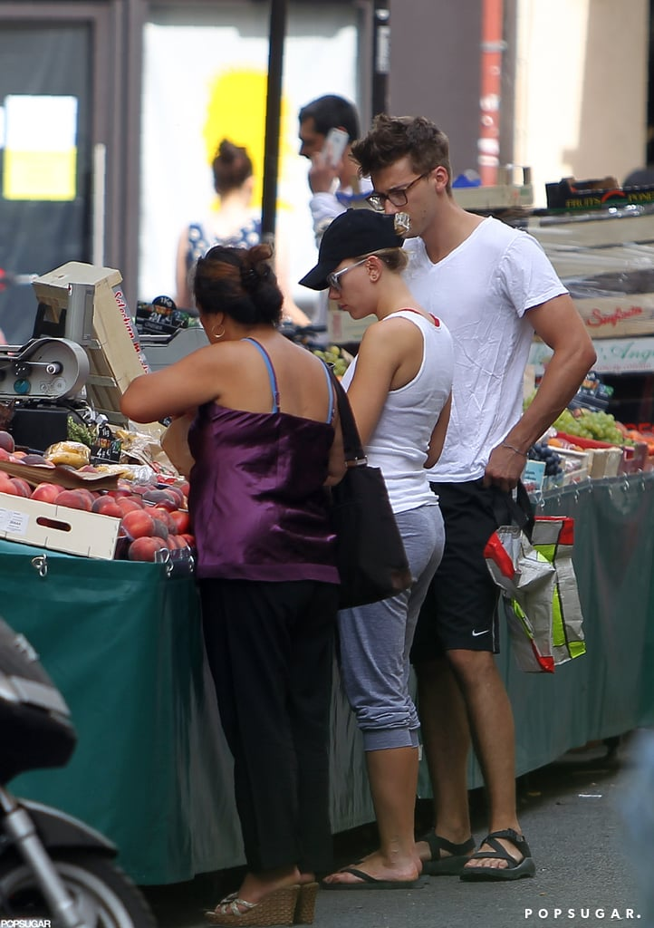 Scarlett Johansson picked up some fruit at a market.