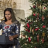 Michelle Wore a Festive Navy Dress While Giving a Speech