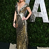 Marisa Miller brought looked sexy and glamorous in a gold sequined dress with a plunging neckline.