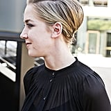 Go for a modern take on a vintage bouffant with a tousled side part and slicked sides. Photo by Caroline Voagen Nelson