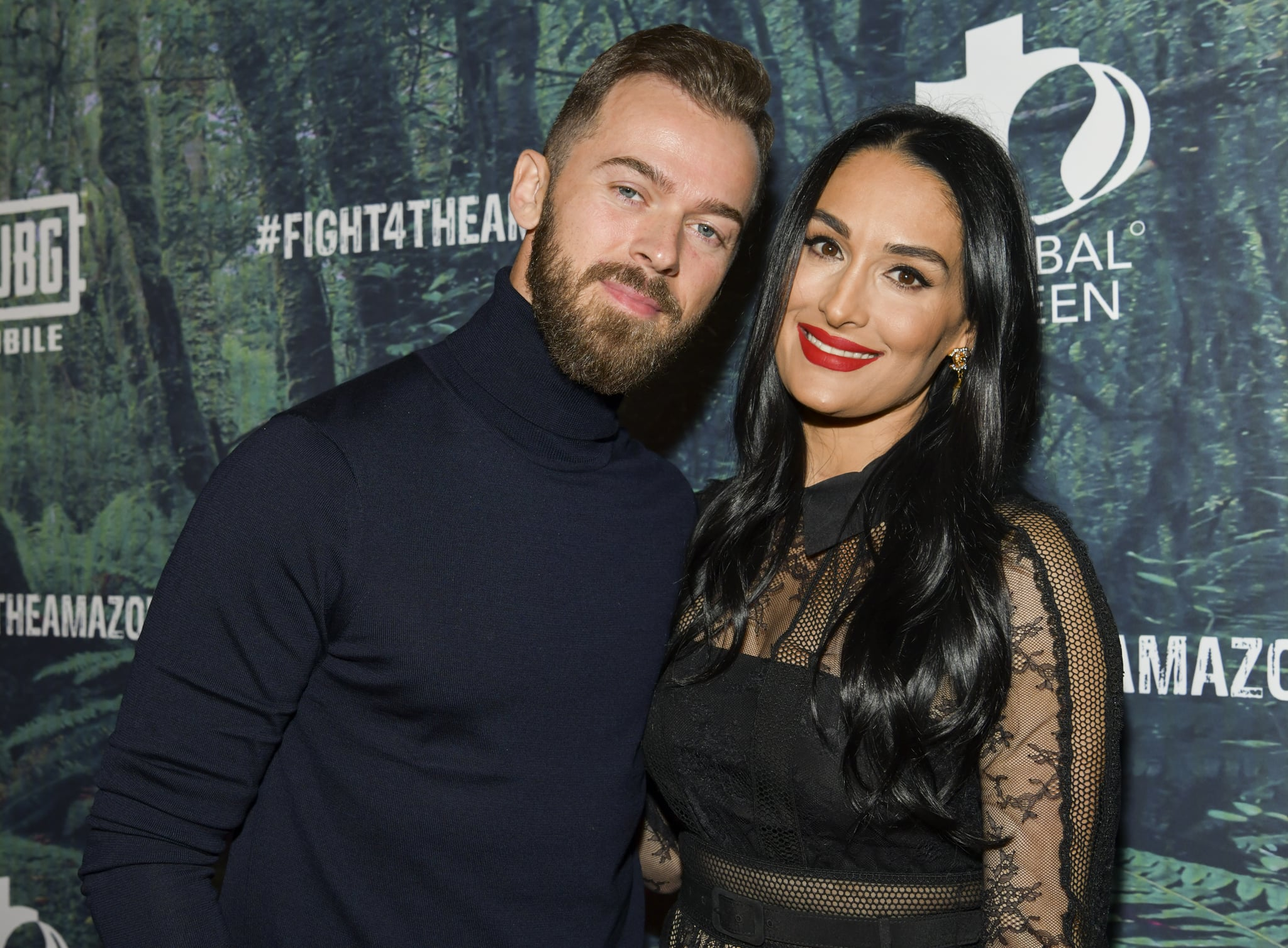 LOS ANGELES, CALIFORNIA - DECEMBER 09: Artem Chigvintsev (L) and Nikki Bella attend the PUBG Mobile's #FIGHT4THEAMAZON Event at Avalon Hollywood on December 09, 2019 in Los Angeles, California. (Photo by Rodin Eckenroth/Getty Images)