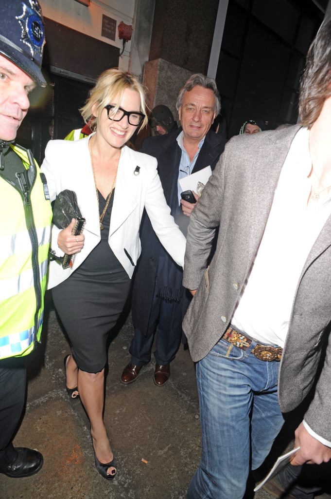 Kate Winslet made her way through the streets of London in a black formfitting dress, black peep-toes, and black-rimmed glasses, all made crisp thanks to a white jacket.
