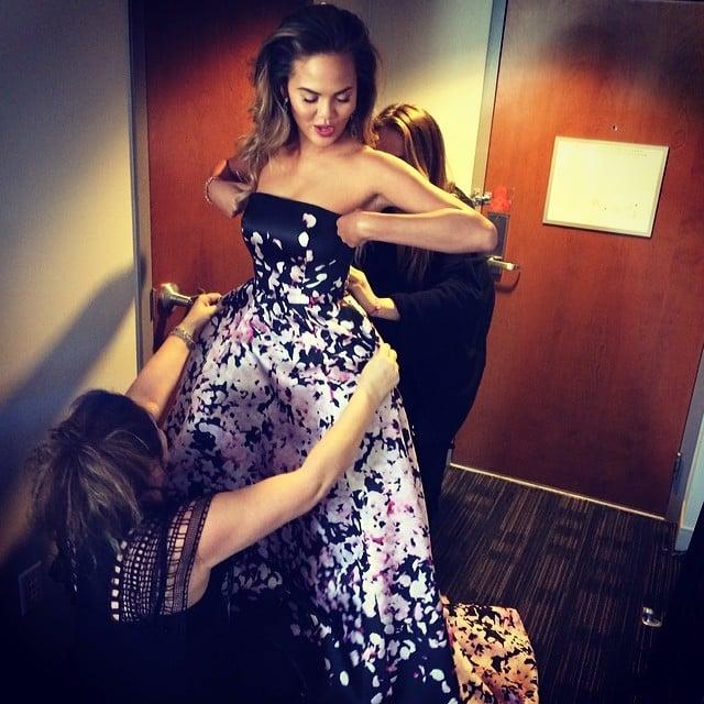 Chrissy Teigen had some help getting into her gown. Source: Instagram user chrissyteigen
