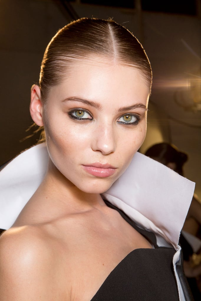 Inky eyeliner on the top and bottom lash lines was the central point of the makeup at Stéphane Rolland.